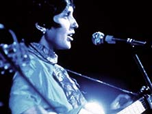 Joan Baez playing at woodstock 1969