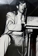 Jerry Lee Lewis singing at piano