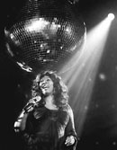 Donna Summer in spotlight with mirror ball